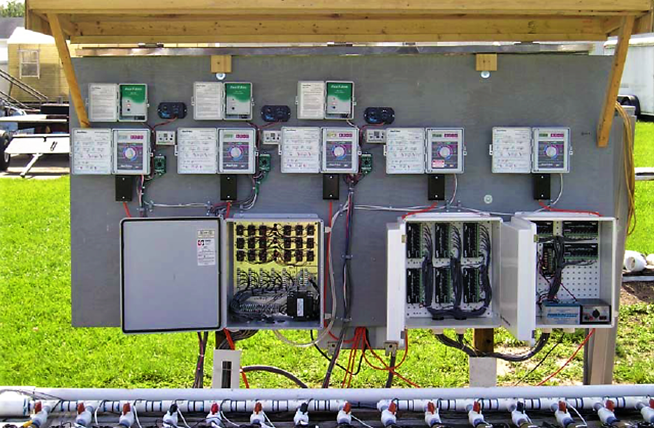Control board showing timers, soil moisture sensor-controllers, solenoid valves wiring, and flowmeters-datalogger. Source: CARDENAS-LAILHACAR (2006)