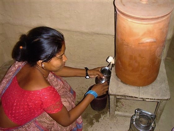 Nepali Women using CSF to treat drinking water. Source: ENPHO (n.y.)