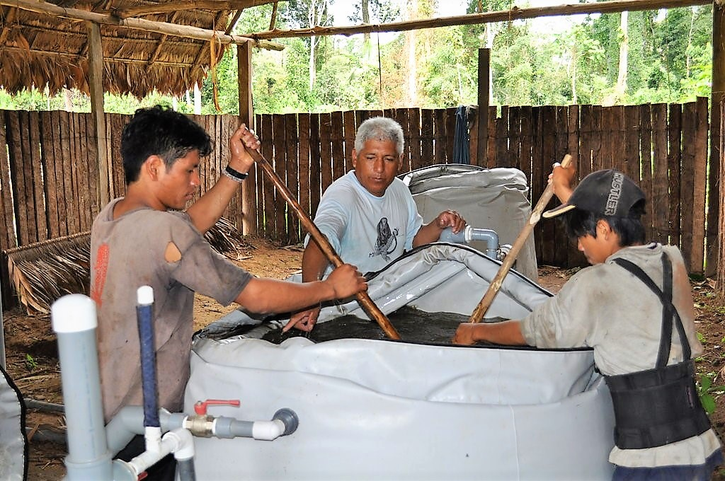 Tayakome's village water committee cleaning their slow sand filters. Source: GLOBAL GIVING (2011)
