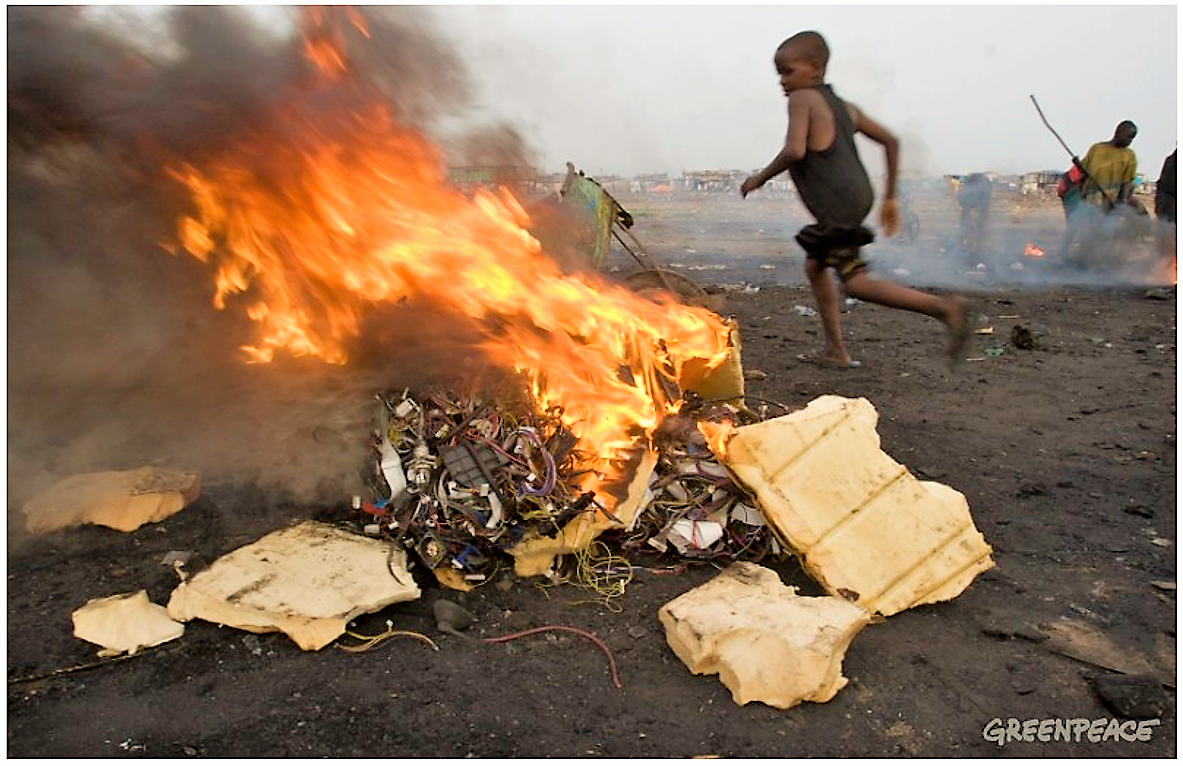 Boys burning electronic cables and other electrical components in order to melt off the plastic and reclaim the copper wiring. This burning in small fires releases toxic chemicals into the environment. Source: GREENPEACE (2008)