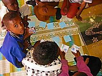 Children playing cards within the CHAST approach. Source: IRC (2006)