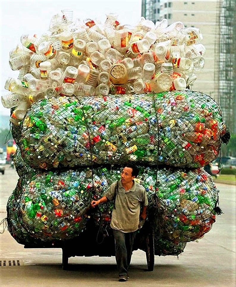 Man transporting empty plastic bottles, China. Source: NATIONALGEOGRAPHICS (2003)