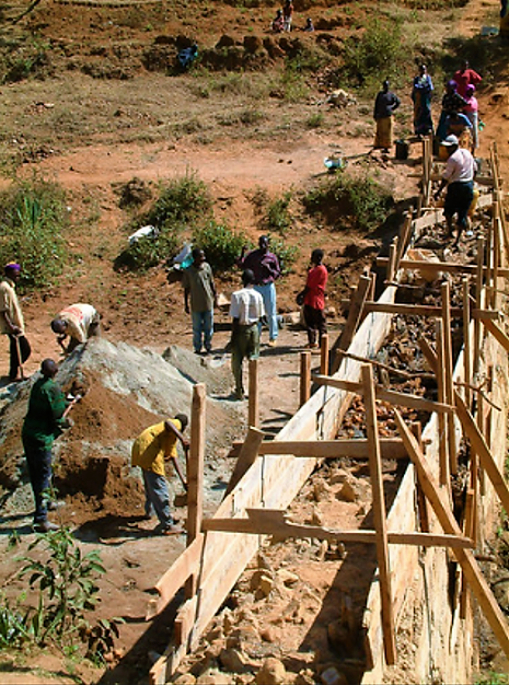Construction of stone masonry dam in Kenya. Source: THISISEXCELLENT (2003)