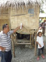 """Hanging urine-diversion dehydration toilet"" in coastal area in Libertad, Misamis Oriental, Philippines. Source: WAFLER (2010)"