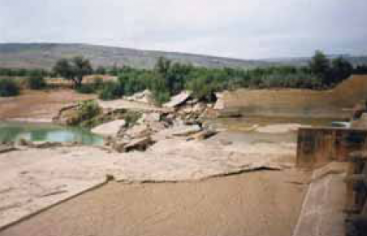 Diversion weir blown up by farmers as it interfered with the base flows, Pakistan. Source: FAO (2010)