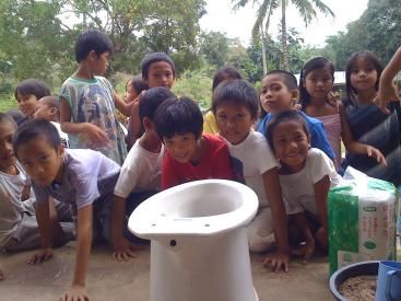 School orientation on correct use of urine separation toilet at elementary school in Baluarte (Cagayan de Oro, Philippines). Source: GENSCH, R. (2009)