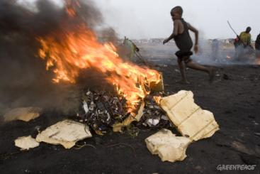 Boys burning electronic cables and other electrical components in order to melt off the plastic and reclaim the copper wiring. This burning in small fires releases toxic chemicals into the environment. Source - GREENPEACE, 2008