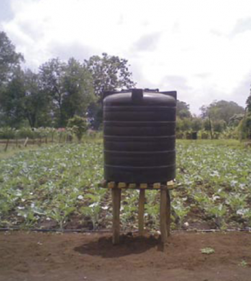 "A low-cost ""farm-kit system"" with a 1000 litre water tank can service up one-eight of an acre. Source: IPTRID (2008)"