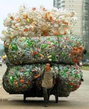 Fig. 1: Chinese man transporting empty plastic bottles and containers. Source: NATIONALGEOGRAPHICS (2003)