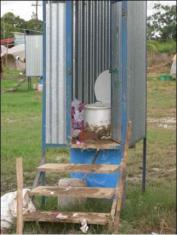 Urine diverting toilet in Bolivia, displaying the toilet paper management problem described in the example above