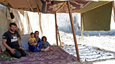 Syrian refugees in their makeshift tent in Erbil. Source: REVERS (2016).