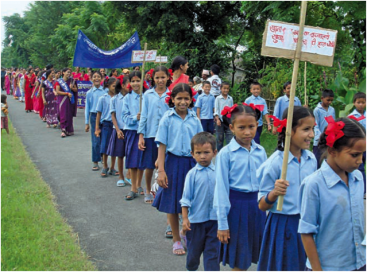 Children and women participating in a sanitation promotion rally in Nepal. Source: ADHIKARI & SHRESTHRA (n.y.)