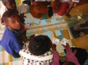 Children playing cards within the CHAST approach. Source: UNICEF 2006